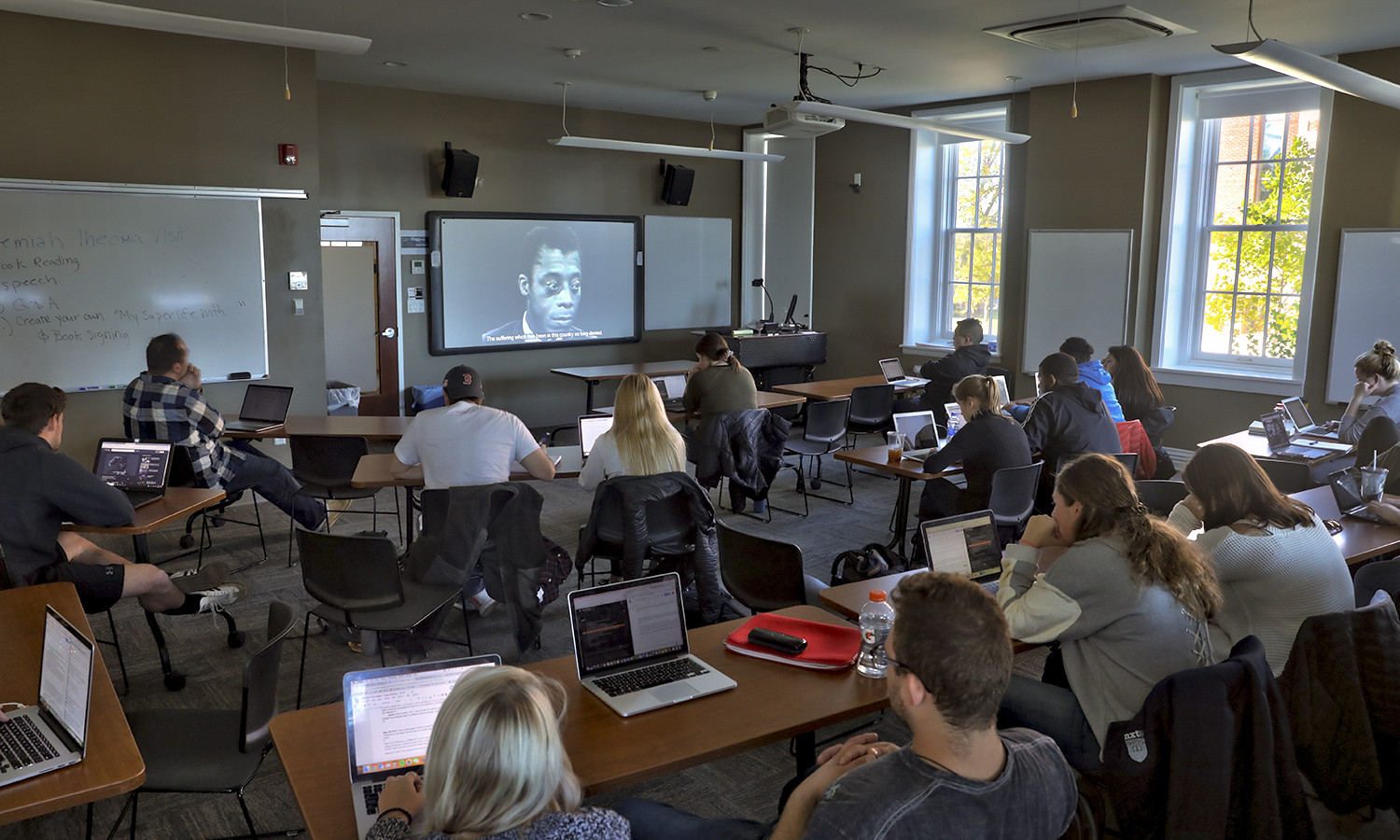 "Students watch a screening of ""I Am Not Your Negro"" as part of ""Perspectives of Edcation"" with VIsiting Assistant Professor of Education Jacob Bartholomew."