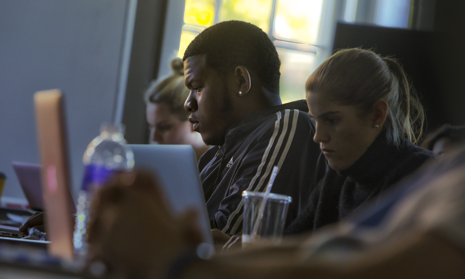 Shaamar Samuel â18 and X take live notes during a screening of James Balwinâs film âI Am Not Your Negroâ during âPerspectives of Educationâ with  VIsiting Assistant Professor of Education Jacob Bartholomew in Merritt Hall.