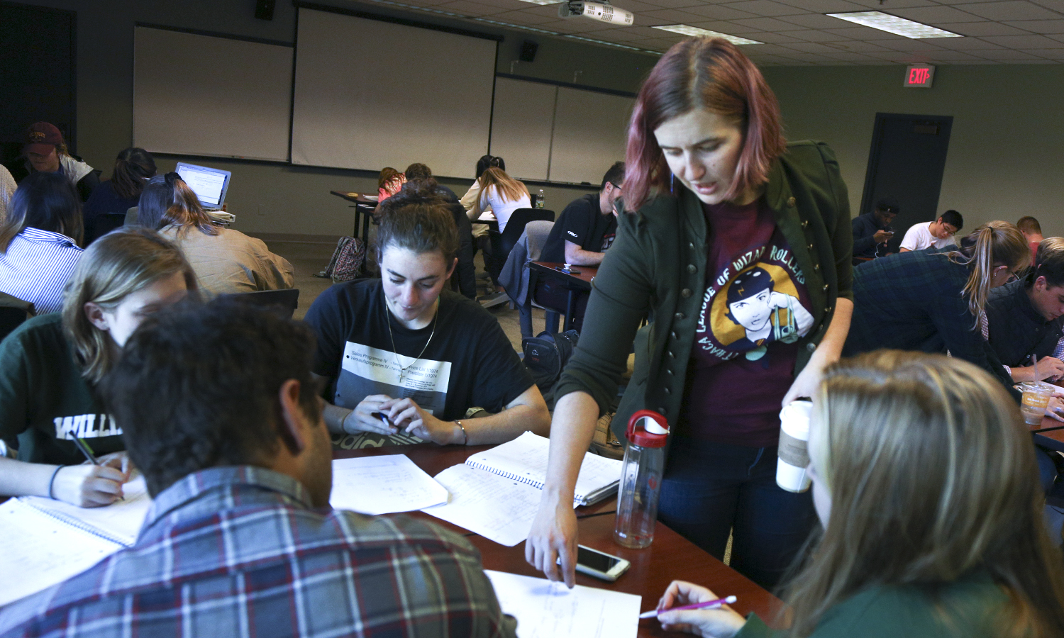 "Assistant Professor of Mathematics and Computer Science Jennifer Biermann helps students with a problem set as part of ""Calculus I"" in Gulick Hall."