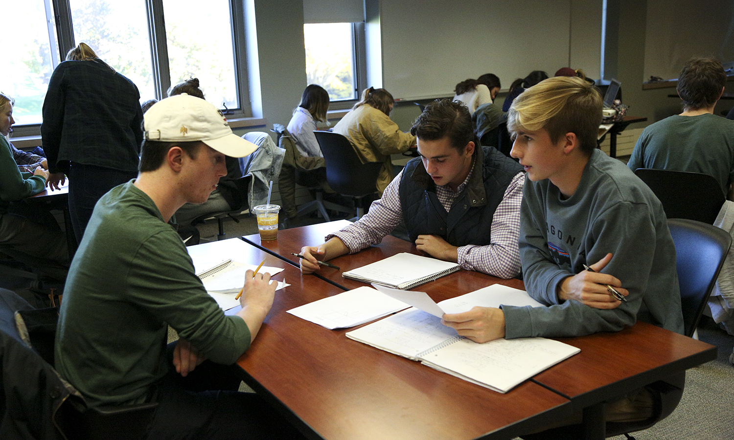 "Students work in groups during lab for ""Caclulus I"" with Assistant Professor of Mathematics and Computer Science Jennifer Biermann."