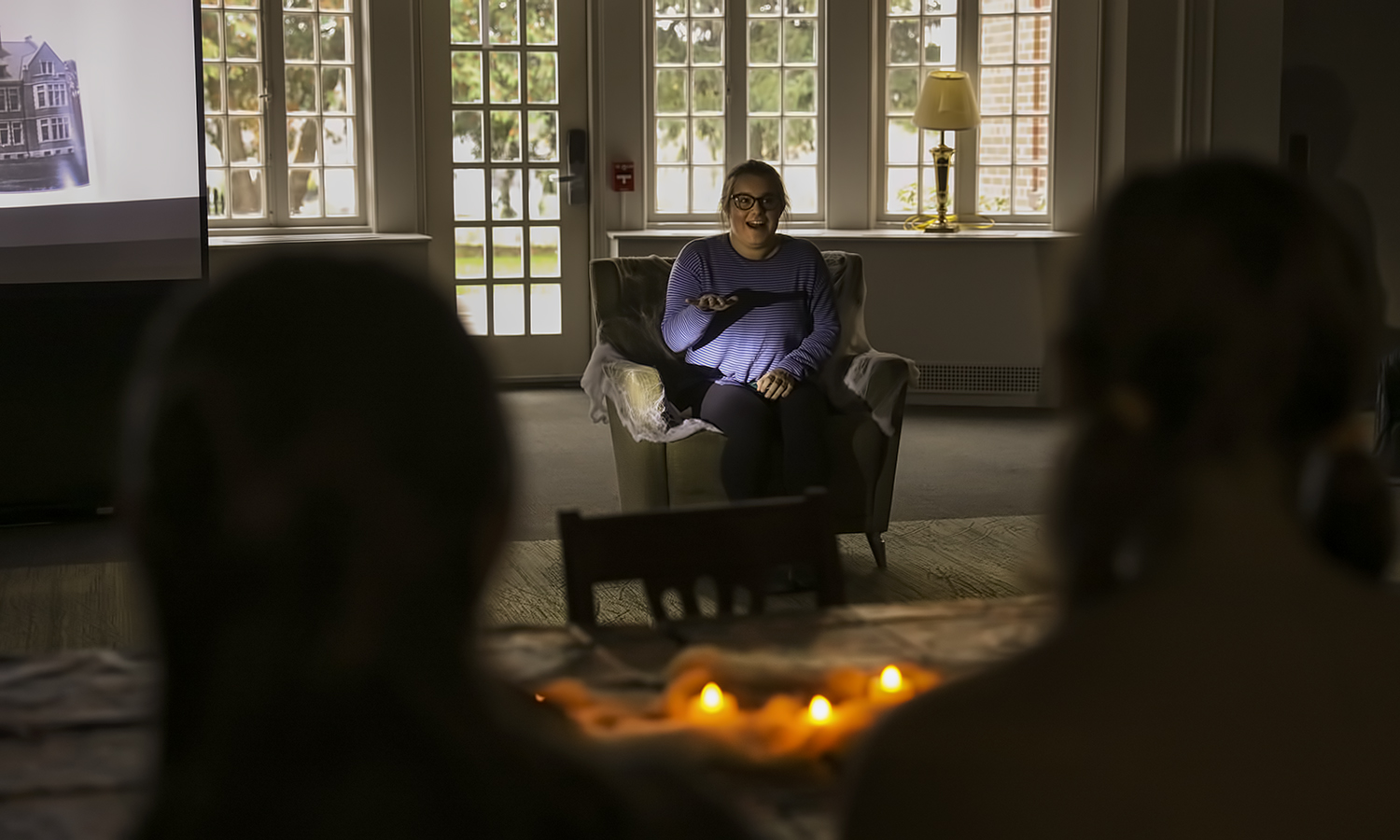 "Alyssa Kelly '19 tells a ghost story about Blackwell House during ""Tea and Tales of William Smith Haunting"" in Comstock Hall."
