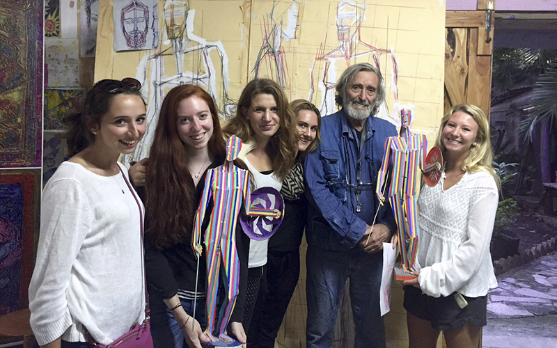 Attached is a picture of several members of our Rome Fall 2015 group with the famous sculptor and architect Nick Spatari.  From left to right are Hannah Brooks, Kayla Jones, Elizabeth Lownie, Alex Lamont, and Paige Pierce.Spatari is a well-know sculptor who has developed an art center and retreat in Calabria where we traveled for an extended field trip.  His work is quite remarkable, using tiles and vivid colors to create images of historical and contemporary life.  The model shown here is a commentary on the famous Riace Bronzis.Best wishes!Jack