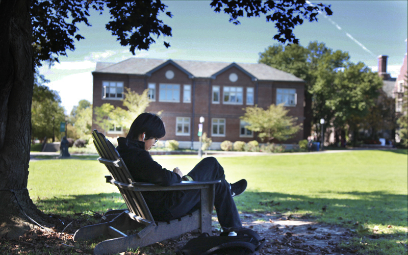 Likuan Wang studying in the quad