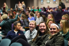 William Smith sqaush teammates Cashel McCarthy '18, Erin Casey '16, and Katie Hill '16 gather for Dr. Michelle Robin's lecture in the Albright Auditorium on Monday night. Chiropractor, Chief Wellness Officer, founder of Your Wellness Connection and best selling author of Wellness on a Shoestring, spoke to William Smith athletes about optimizing their mental and physical abilities through simple life changes.