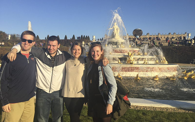 Danny Kot, Mike Rusk, Ashley Lyon, and Madeline Boles at the palace of Versailles during a class trip to Paris