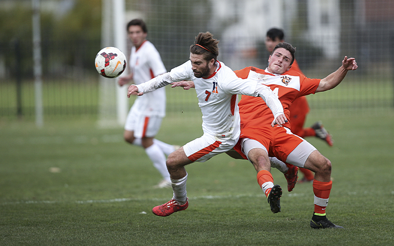 Statesmen senior Jacob Fox gets by the RIT defense during Saturdays Liberty League matchon Cozzens Field.  Hobart finished the regular season with a 3-1 win over the Tigers.