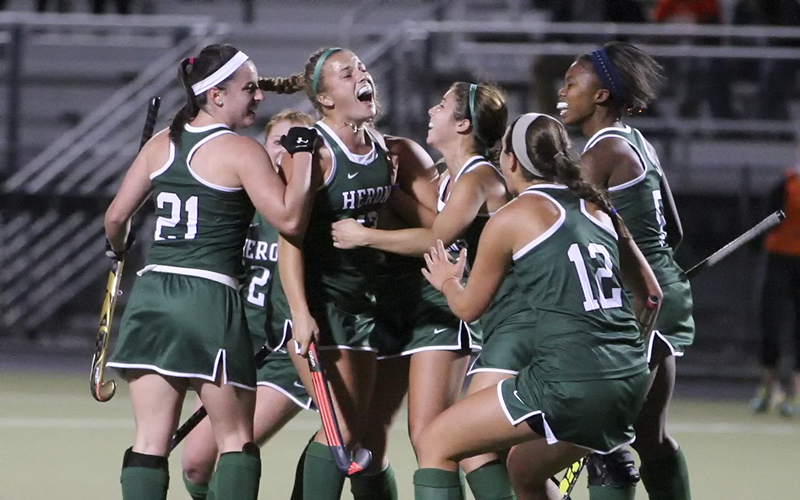 William Smith Field Hockey celebrate with Sophmore Hannah Wood after her 2nd goal against Vassar College in Wednesday nights Liberty League Semi Final game on McCooey Field. Wood scored all four goals for the Herons tieing  single-game record and advances William Smith to Saturdays home field match-up agaist U of R at 11am.