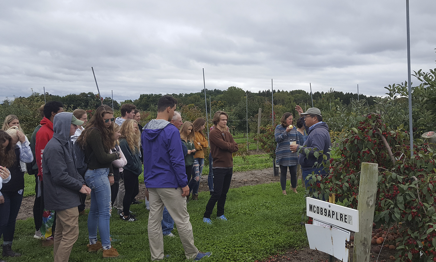 "Students in the ""Sustainable Living and Learning"" first-year seminar and learning community tour the Cornell Apple Repository in Geneva, N.Y."