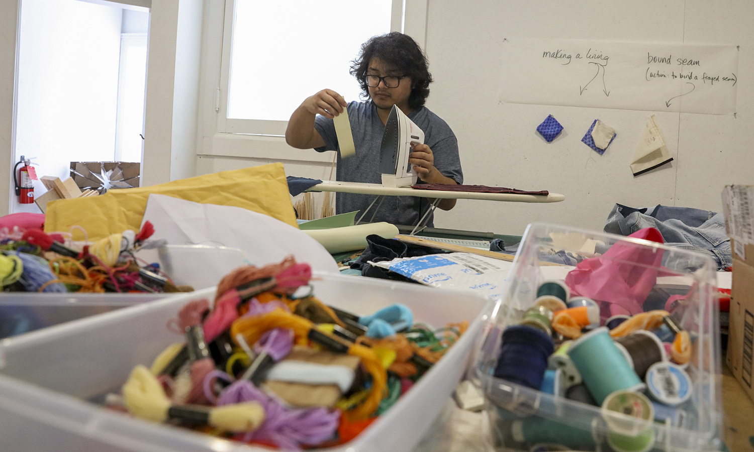 "Shailesh Budhathoki '19 explores the medium of fabric art during ""Introduction to Architectural Design II"" with Associate Professor of Art and Architecture Kirin Makker."