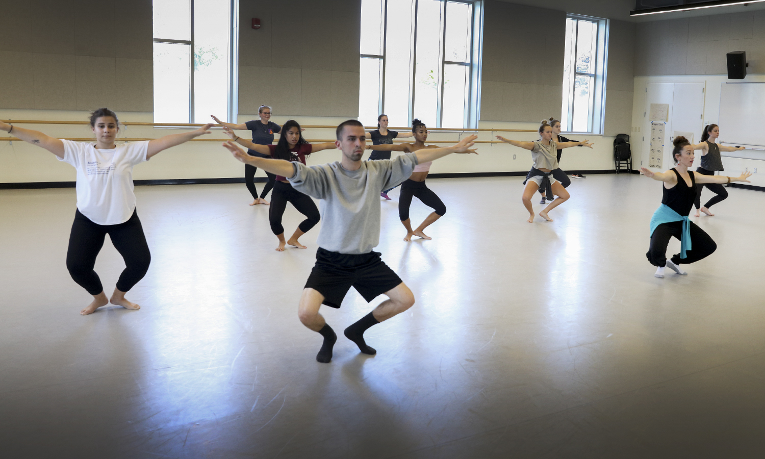 "Students in ""Jamaican Modern Dance"" taught by Assistant Professor of Dance Kelly Johnson warm up. The course is a synergy of European and African dance characteristics."