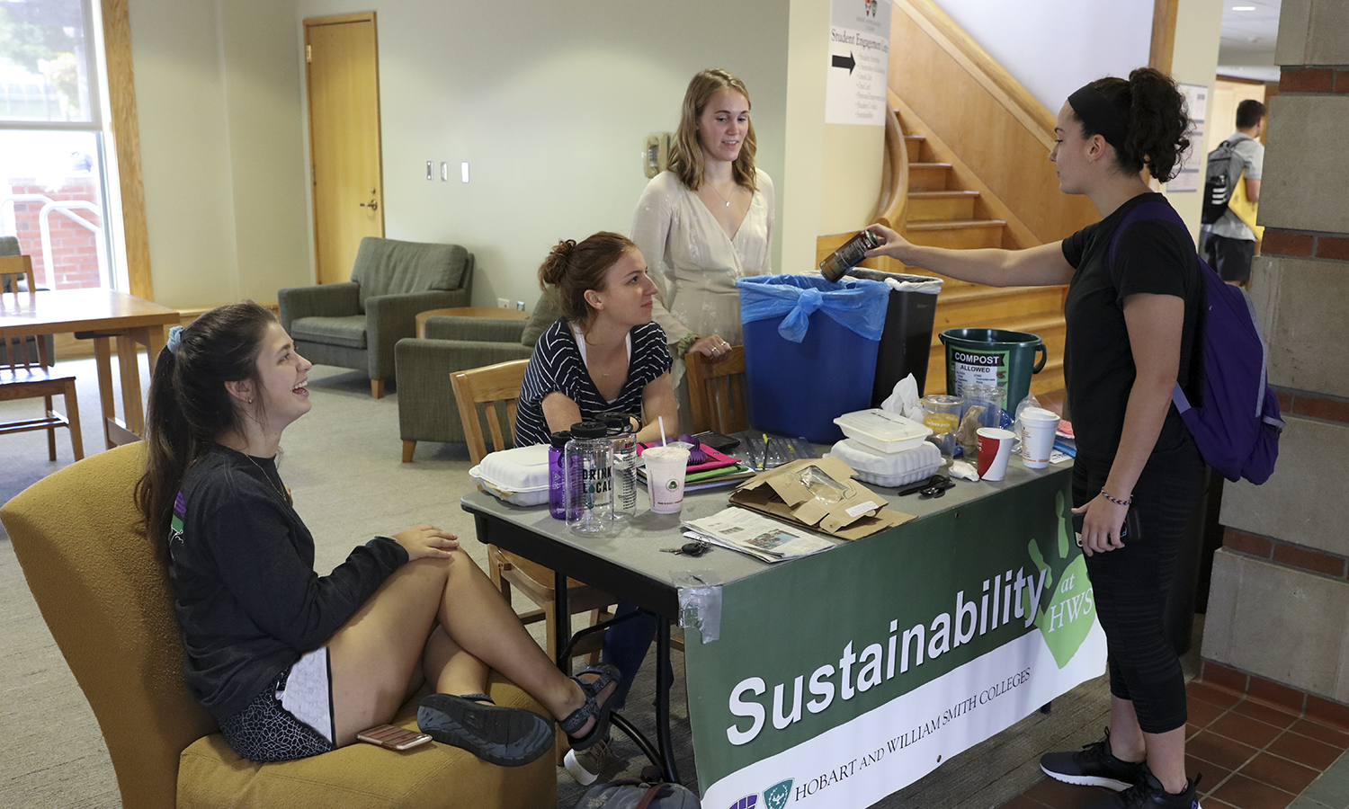 EcoReps Teya Lucyshyn '19, Sarah Boynton '19 and Daria Stacy '19 share landfill diversion initiatives with Kaitlin Hunt '19, including recycling and composting options.