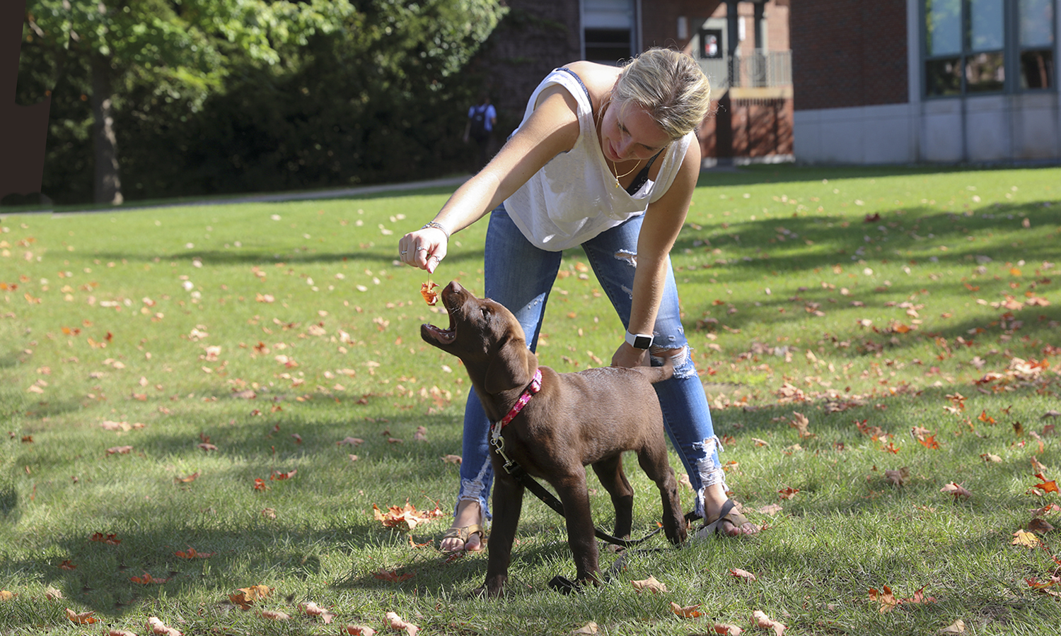 Maura McCarthy '21 and Brownie play on a warm fall afternoon.