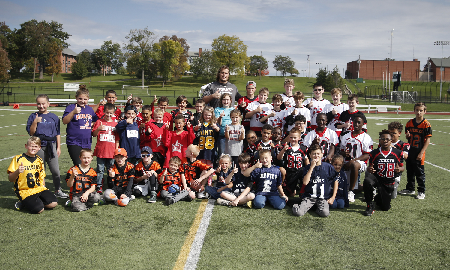 Guard for the Tampa Bay Buccaneers Ali Marpet '15 poses with Geneva Elementary School students.