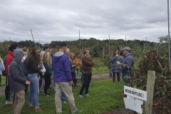 """Students in the """"Sustainable Living and Learning"""" first-year seminar and learning community tour the Cornell Apple Repository in Geneva, N.Y."""