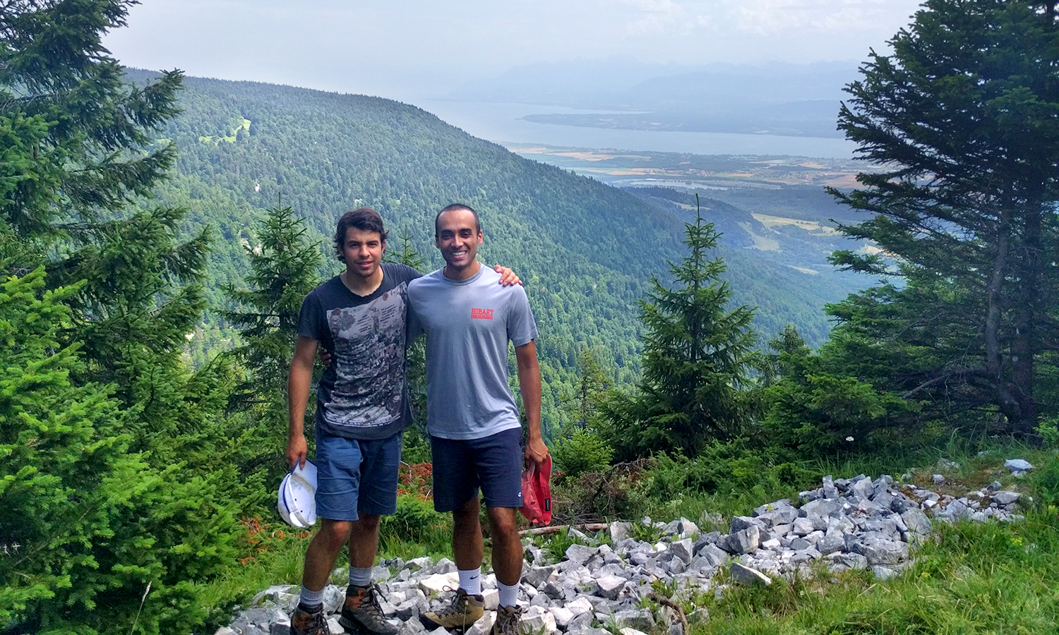 Sigma Chi brothers Sebastien Sauvagnat '17 and Subin Nepal '15 pose for a photo on top of Combe du Beau, overlooking lake Geneva.