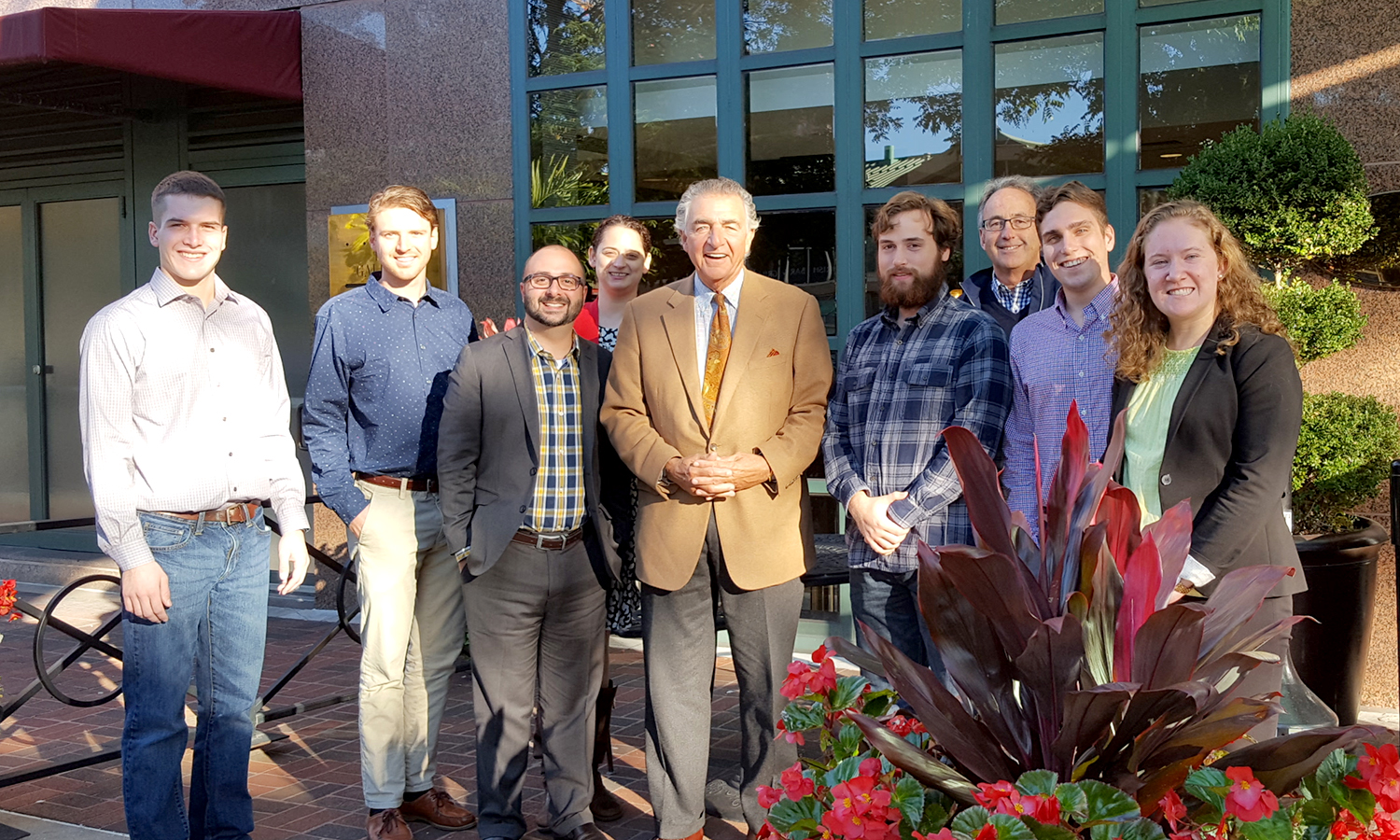 Chair of the Board of Trustees Tom Bozzuto '68 (middle) gathers with HWS students, faculty, and staff attending the Association for Advancement of Sustainability in Higher Education in Baltimore, MD.