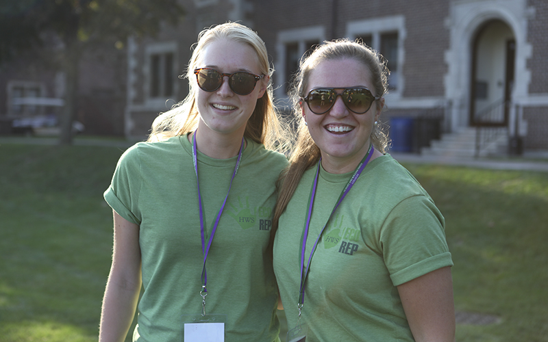 Isa Akerfeldt-Howard '18 (left) and Jane Dowling '18 (right) work as EcoReps assisting First Years on the Quad.