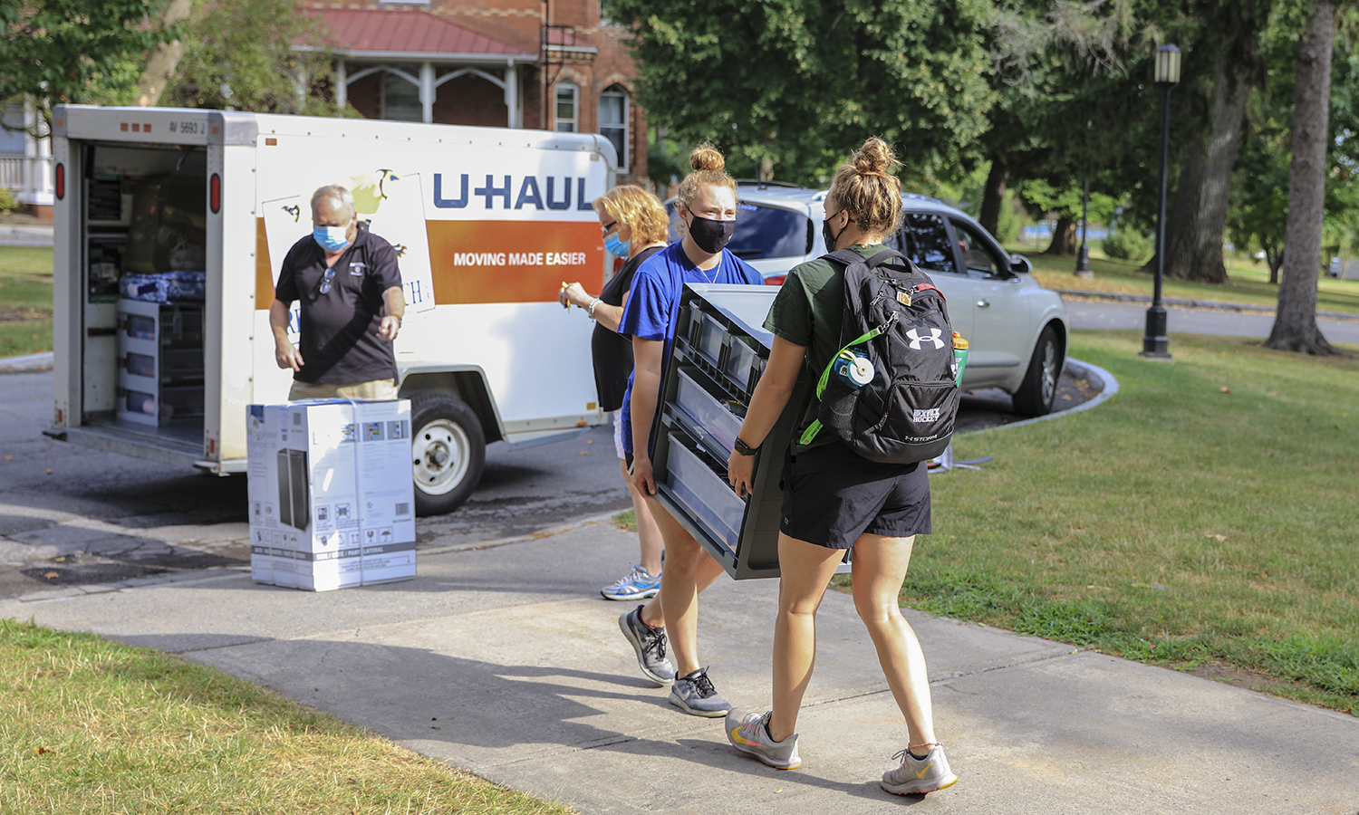 Triplets Move in  KColton, Tiffany Foster (Wearing Black), Sydney Foster (Blue), Brittany Foster (green) Mom and Dad Lisa and Jerry Foster, from Mass.
