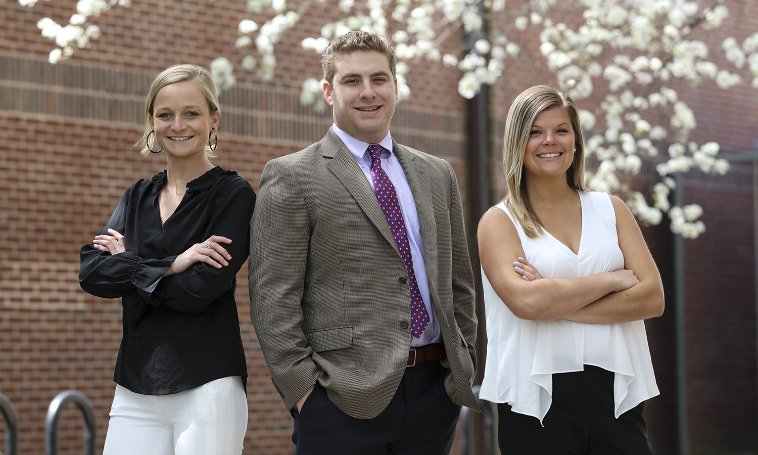 Preston Tansill '18, James Mula '18 and Annie O'Brien '18 pose for a photo. Tansill, Mula and O'Brien have all accepted positions at Aon in Boston, a division of Aon plc, the leading global provider of risk management services, insurance and reinsurance brokerage, and human resources solutions, consulting and outsourcing.
