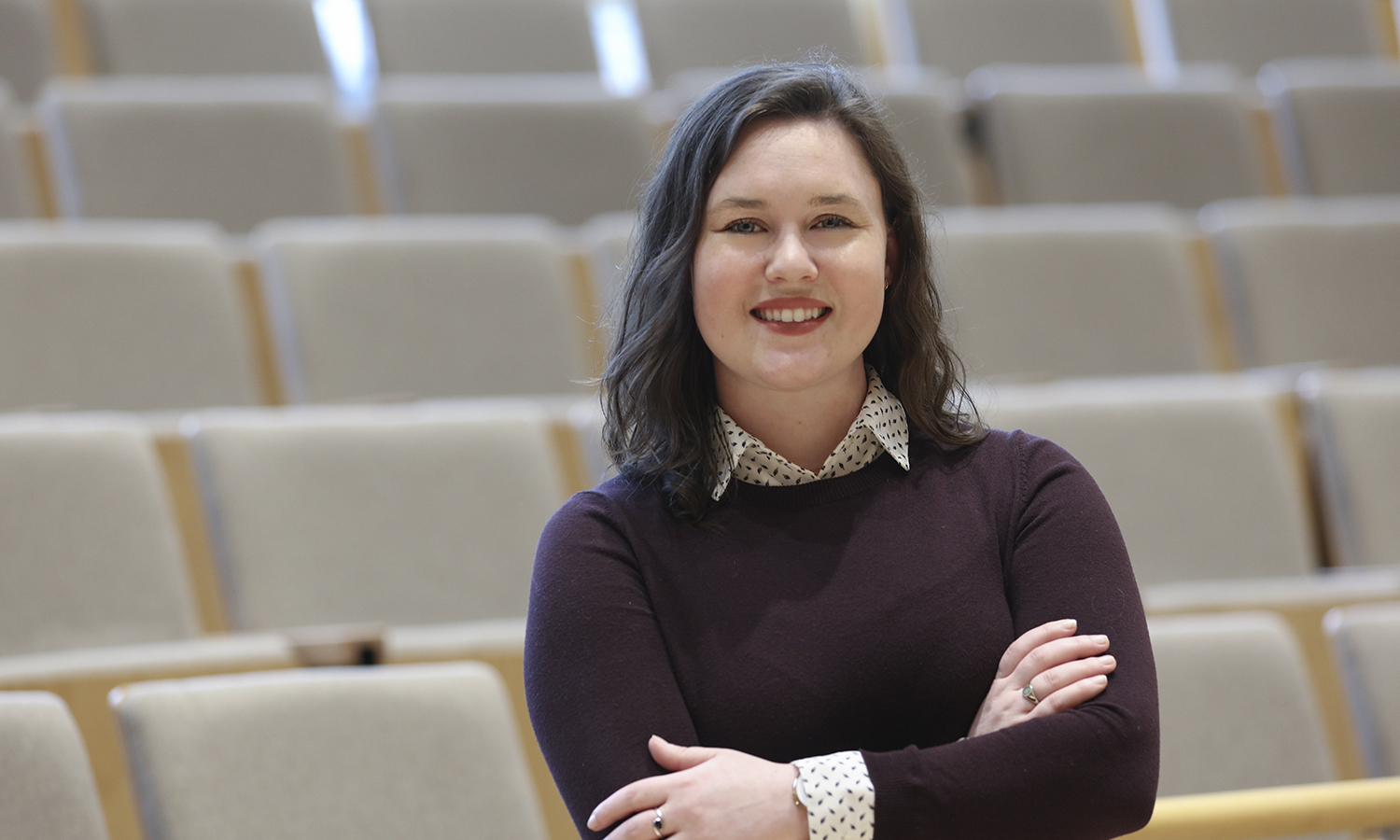 Elena Parkins '18 poses for a photo in Froelich Hall of the Gearan Center for the Performing Arts. Parkins completed her Honors study in choral conducting during the 2017-2018 academic year and recently moved to Rochester, NY to pursue research in the field of child psychology.