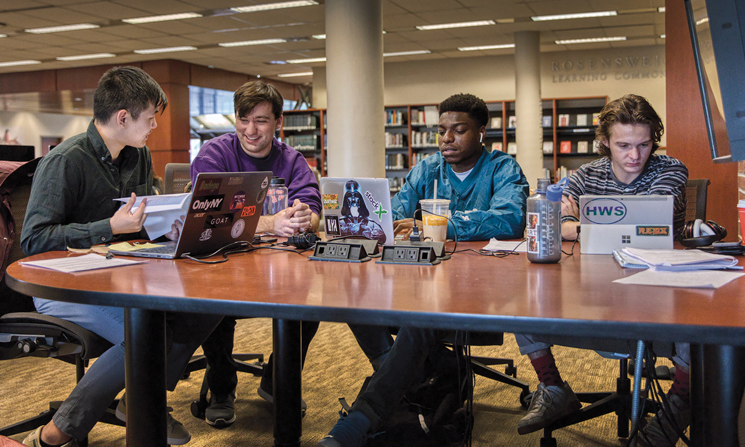 Kevin Lin '20, Hugh Nick Mckenny '20, MAT '21, Israel Oyedapo '20 and Quinn McFeeters '20 study in the Warren Hunting Smith Library.