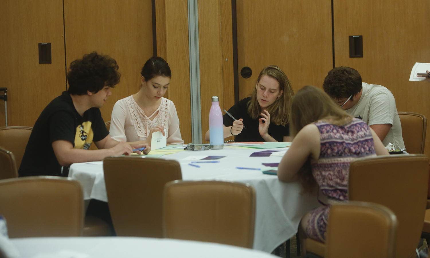 Students write thank-you notes during the Scholarship Reception in the Vandervort Room.