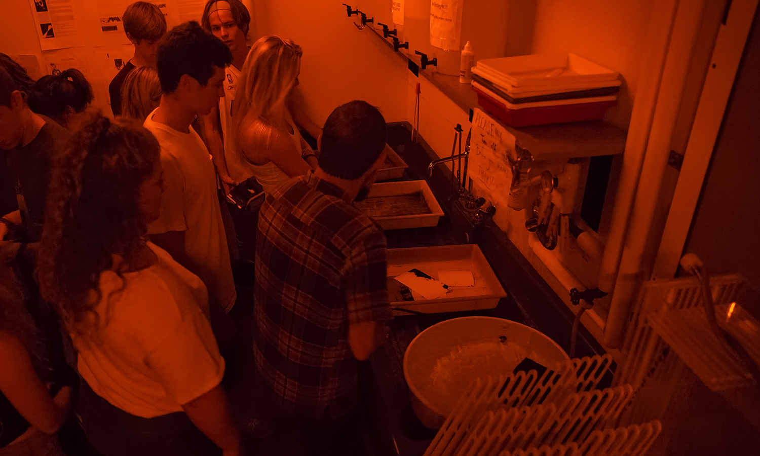 Students develop photos in the darkroom of the  The Goldstein Family Carriage House.