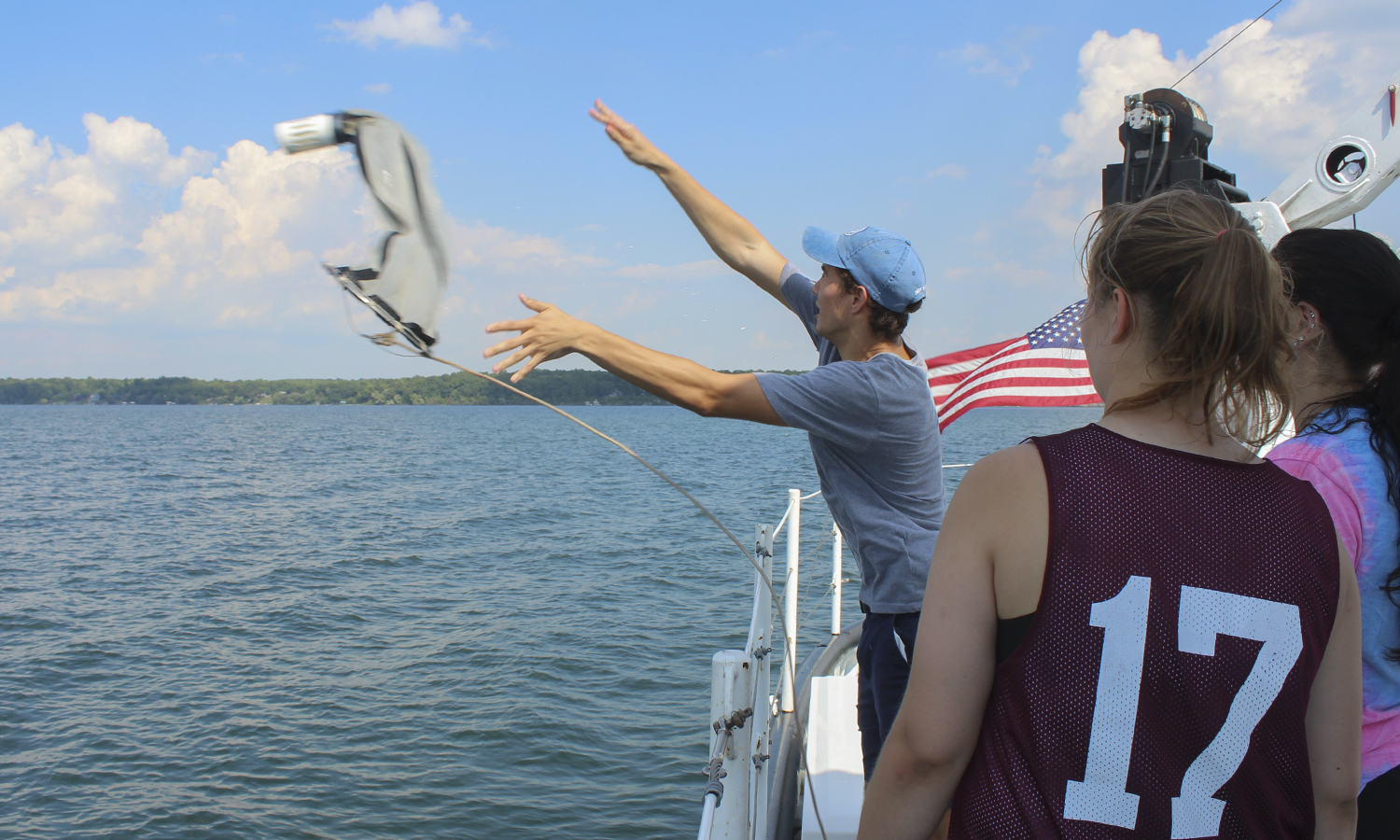 As part of a lab for âAquatic Biologyâ with Associate Professor of Biology Megan brown, Colton Corriveau â21 secures a Bongo Plankton Net before submerging the device in Seneca Lake to collect phytoplankton and zooplankton samples.