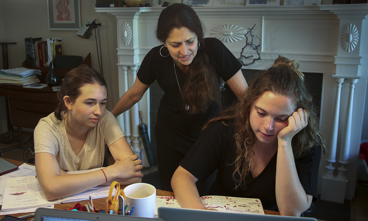 Abbey Frederick '20, Associate Professor of Art and Architecture Kirin Makker and E. Ainsley Rhodes '19 work on a design at Makker's House.