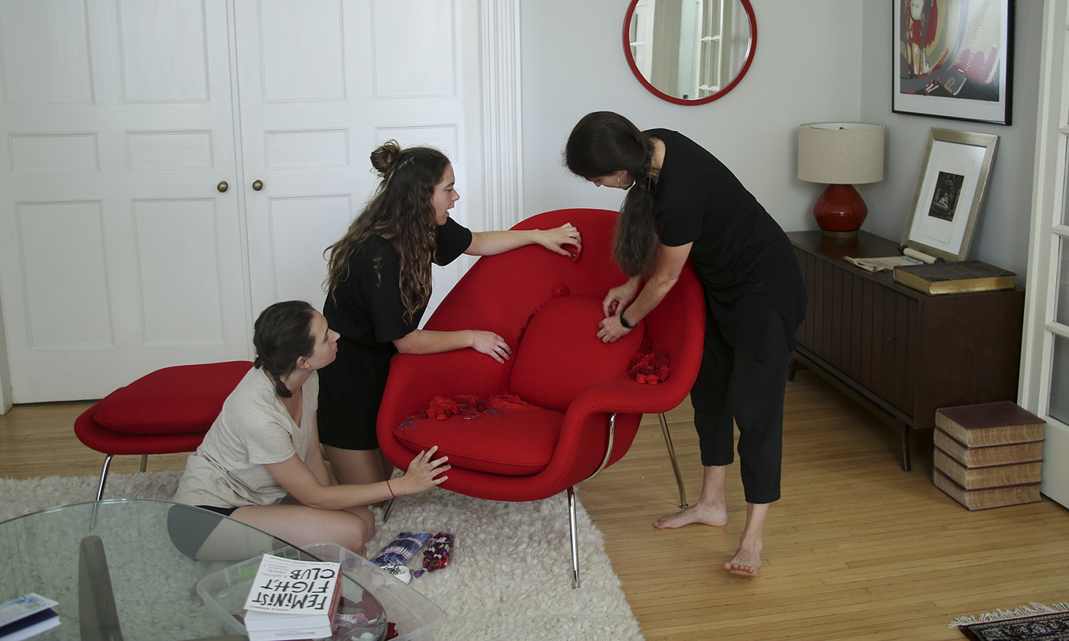 "Abbey Frederick '20, E. Ainsley Rhodes '19  and Associate Professor of Art and Architecture Kirin Makker construct the ""Womb Chair"" using using felted wool applique, fibre art textures and embroidery."