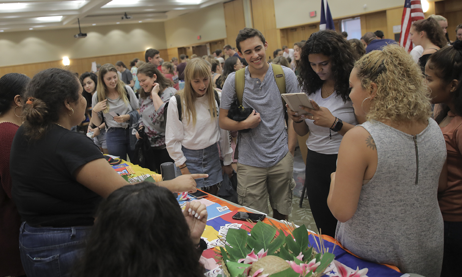 Nele Keller '22 (center left), Robert Russell '22 and Zerina Makhdoomi '22 chat with members of the Latin American Organization during the Involvement Expo.