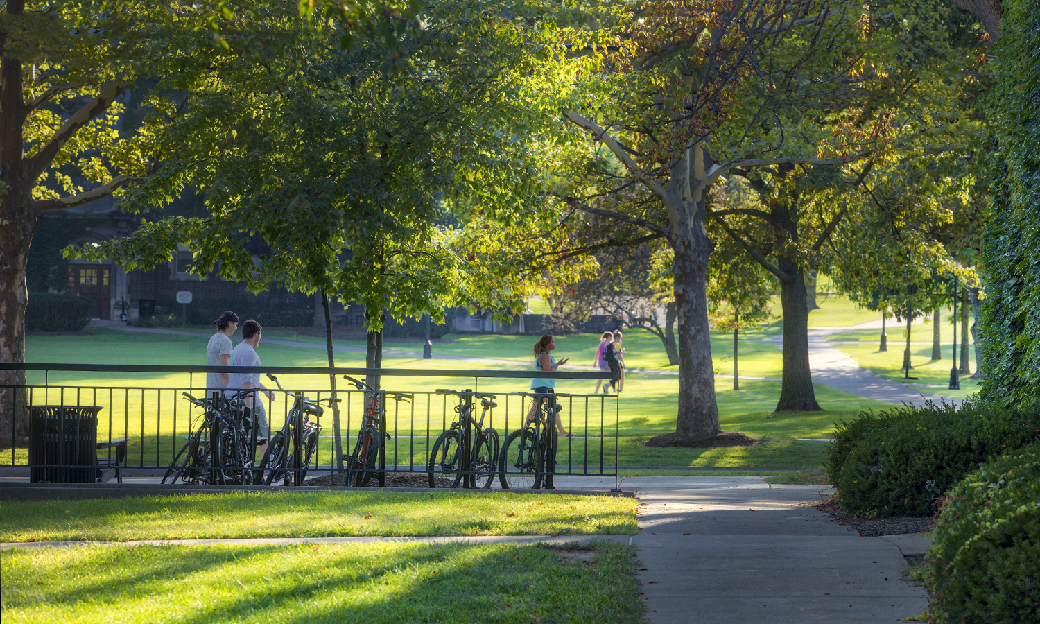 Students walk across campus on Monday evening.