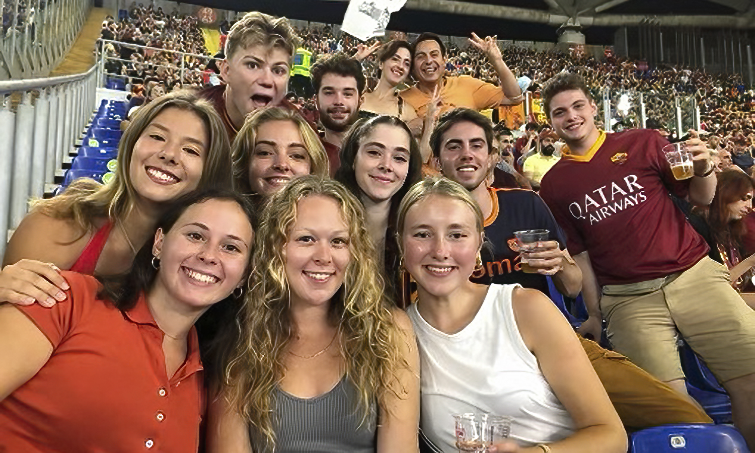 Hobart and William Smith students take a photo during an A.S. Roma soccer match while studying in Italy under the direction of Professor of Art and Architecture Christine Chin.