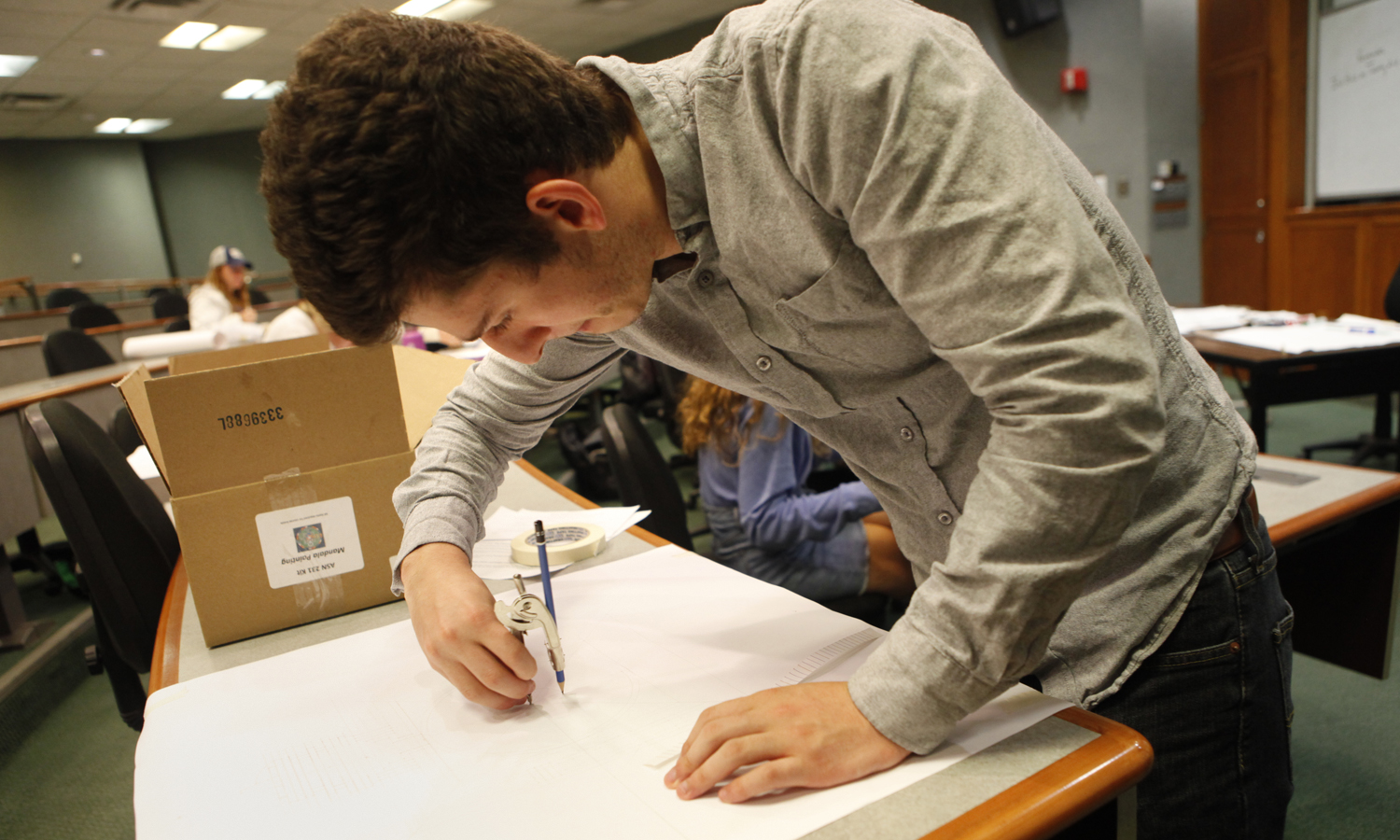 Jesse Maltese '20 begins drawing the pattern for his Tibetan Buddhist sand mandala.