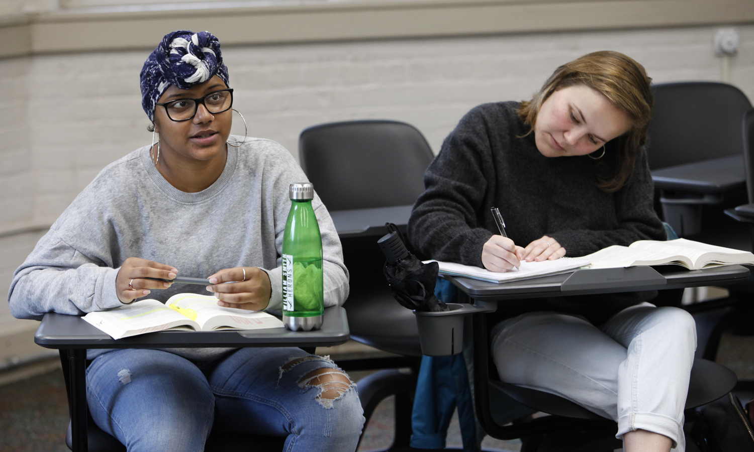 "Jess Ramthal '20 and Carly Shiever 'X take notes for ""Victorian Literature"" with Associate Professor of English Nicola Minott-Ahl in Smith Hall."