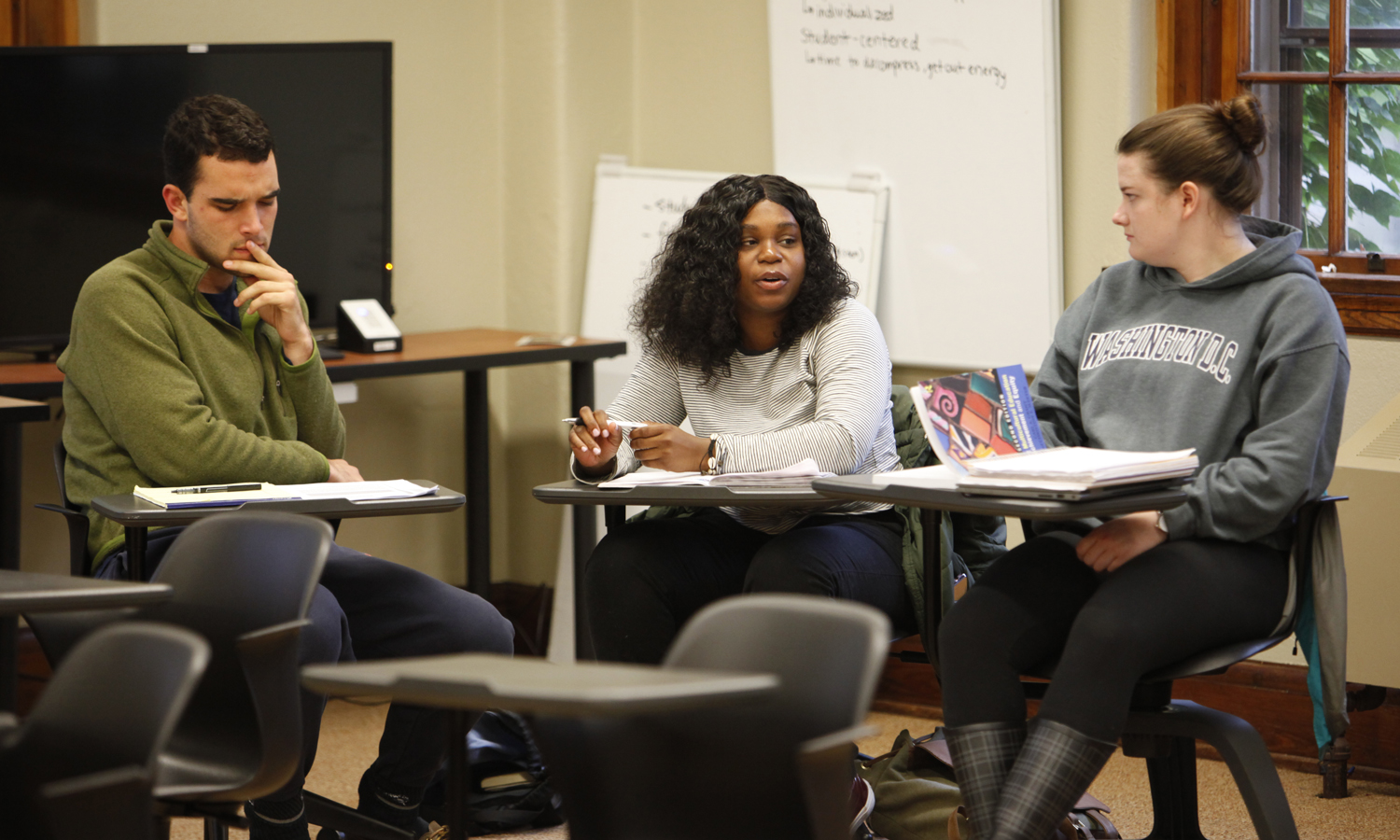"Students discuss the role of identity in education as part of ""Teaching Equity"" in Coxe Hall. The class is taught by Interim Dean of Hobart College and Professor of Education Khuram Hussain and Associate Professor of Education James MaKinster."