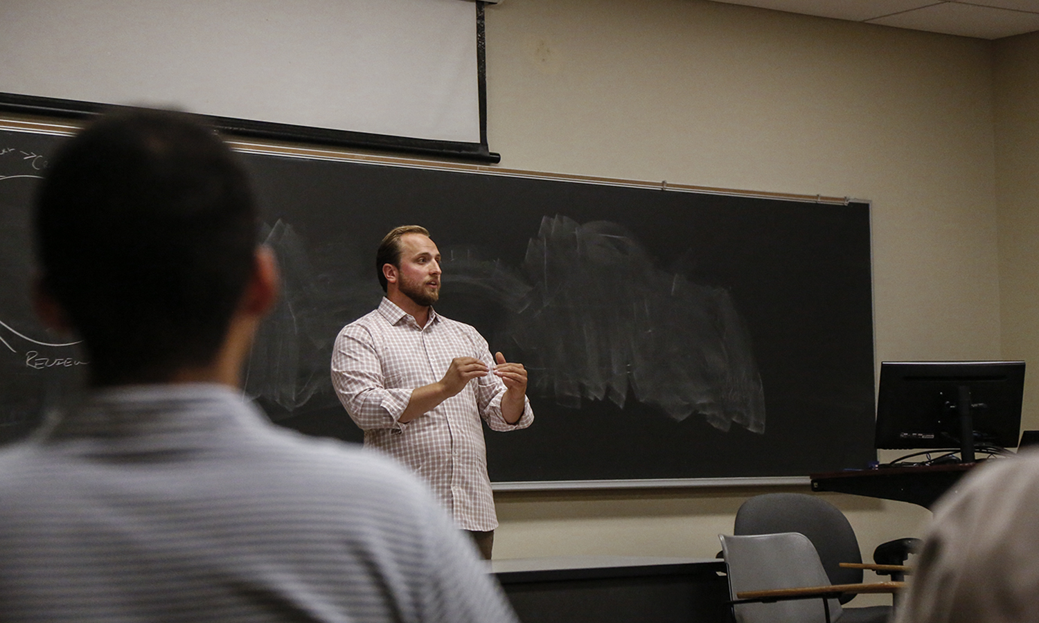 Founder of Phoodie Marketing, Bradify INK and Dig In Foods Sam Miller '12 discusses his entrepreneurship in the food and beverage grocery space with students in Stern Hall.