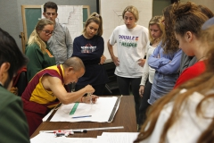 Students watch as The Venerable Tenzin Yignyen, instructor of Asian languages and cultures starts begins the sacred practice of creating a Tibetan Buddhist sand mandala.