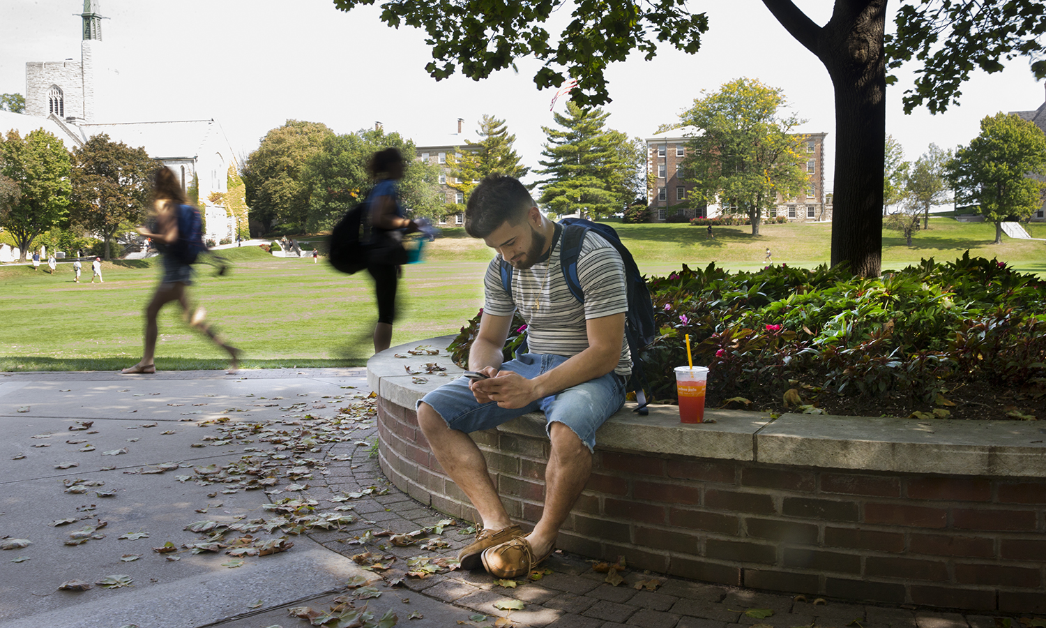 Christian Caban '18 checks his email between classes.