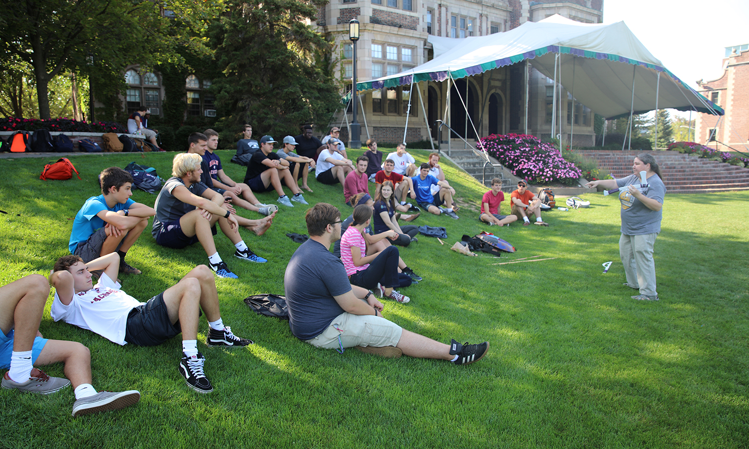 """On the Quad, Associate Professor of Classics Leah Himmelhoch speaks to students in her class """"Ancient Warfare"""" about the types of weapons used in the early bronze age."""