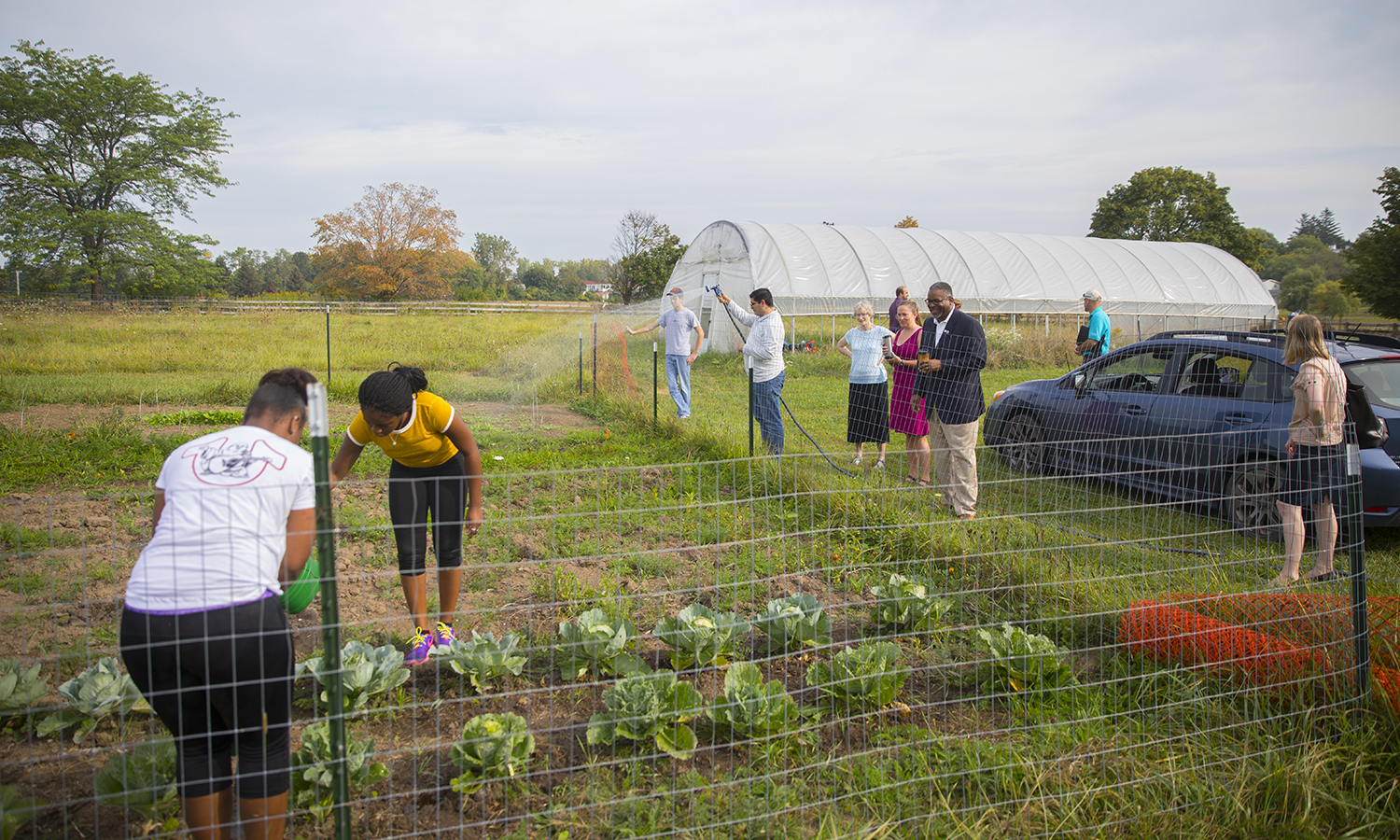 Greg Vincent visits Fribolin Farm with Faculty and Staff.  Students here tend a garden.