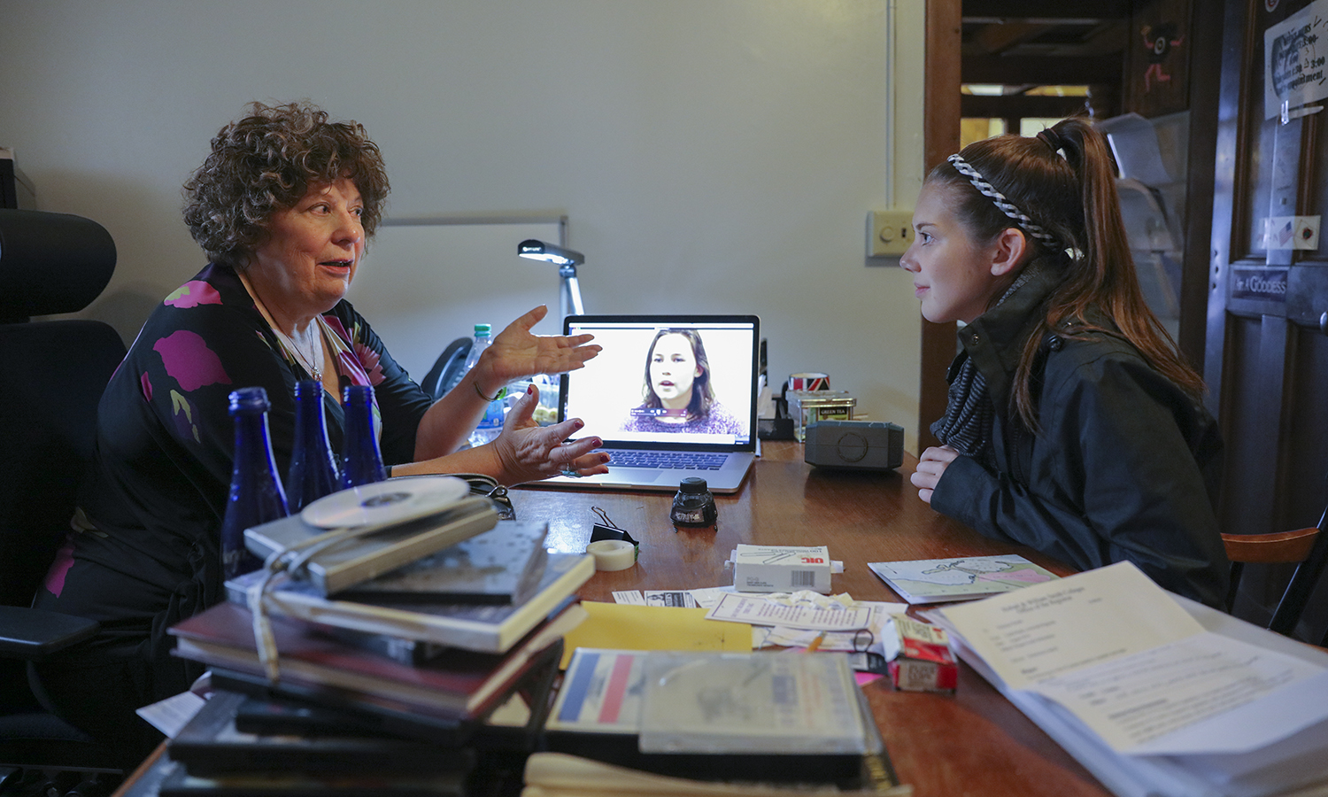 """Professor of Media and Society Linda Robertson meets with Gabriella Goodwin '19 about her project for Robertson's class """"Introduction to Social Documentary"""". Goodwin created a three-minute piece highlighting psychological research indicating that certain kinds of music can improve learning."""