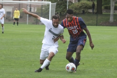 Derrick Acheampong '19 battles for possession during Hobart's loss to Skidmore College on Saturday.
