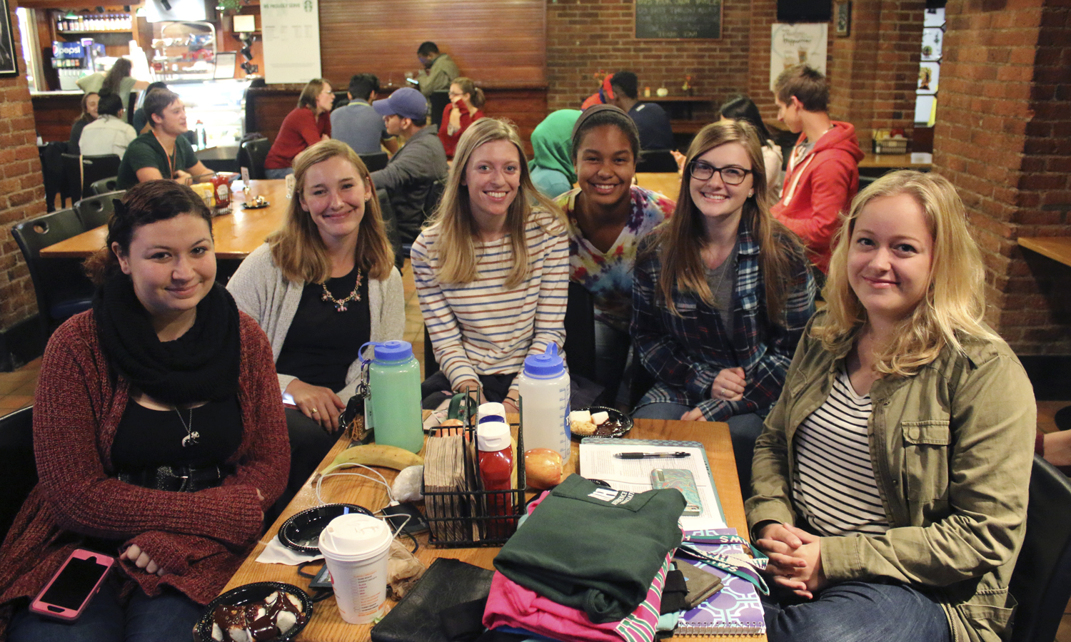 "Katie Burns '18, Ashley Testa '19, Jerlin Garo '17, Emily Sparaggs '17, Madeline Boles '17 and Emma Herbst '17 pose for a group photo during the ""Fondue Friday Face-off"" in the Cellar Pub."