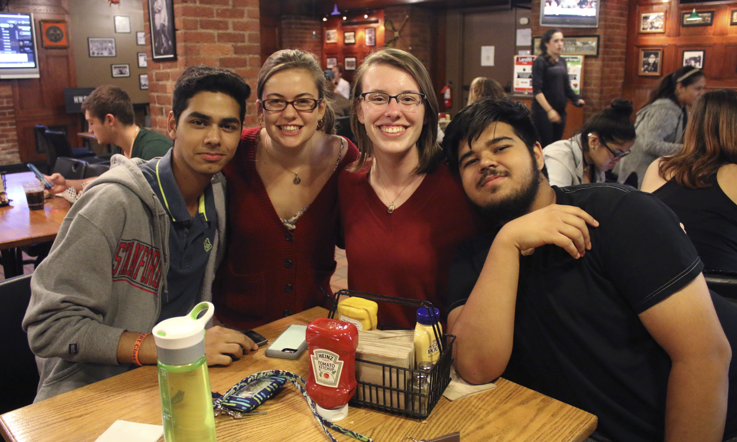 "Hamdan Ahmed '20, Tori Swanson '20, Carly Kelly '20 and Zohaib Ahmad '20 gather for a photo during the After Dark Series event ""Fondue Friday Face-off."""