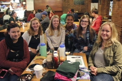 """Katie Burns '18, Ashley Testa '19, Jerlin Garo '17, Emily Sparaggs '17, Madeline Boles '17 and Emma Herbst '17 pose for a group photo during the """"Fondue Friday Face-off"""" in the Cellar Pub."""