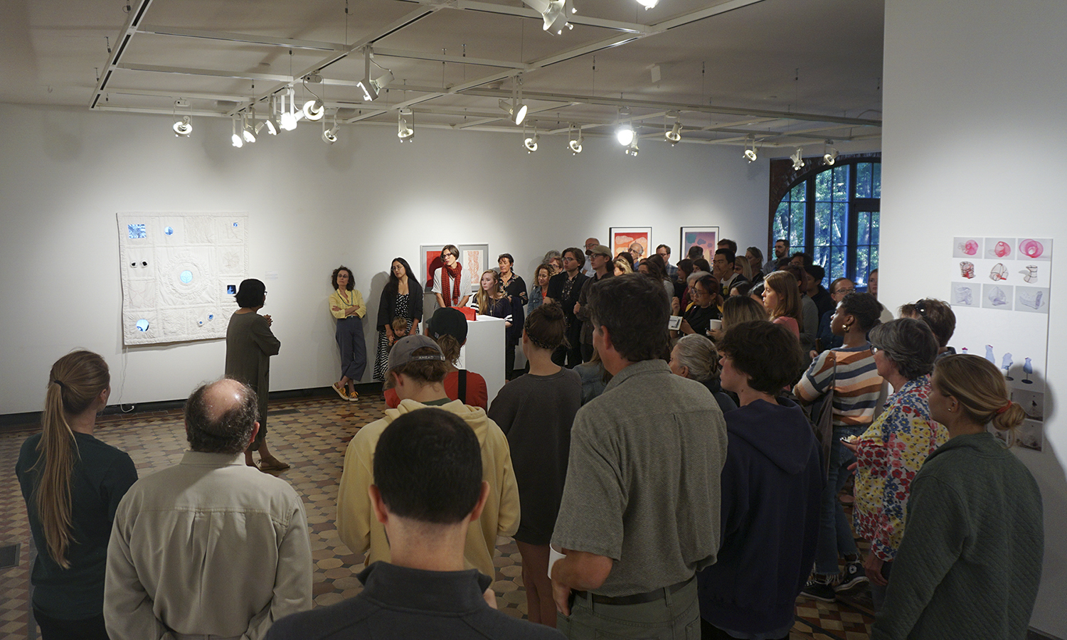 Professor of Art and Architecture Phillia Yi welcomes students and thier families to the Faculty Art Show in the Davis Gallery at Houghton House on Friday of Homecoming and Family Weekend.
