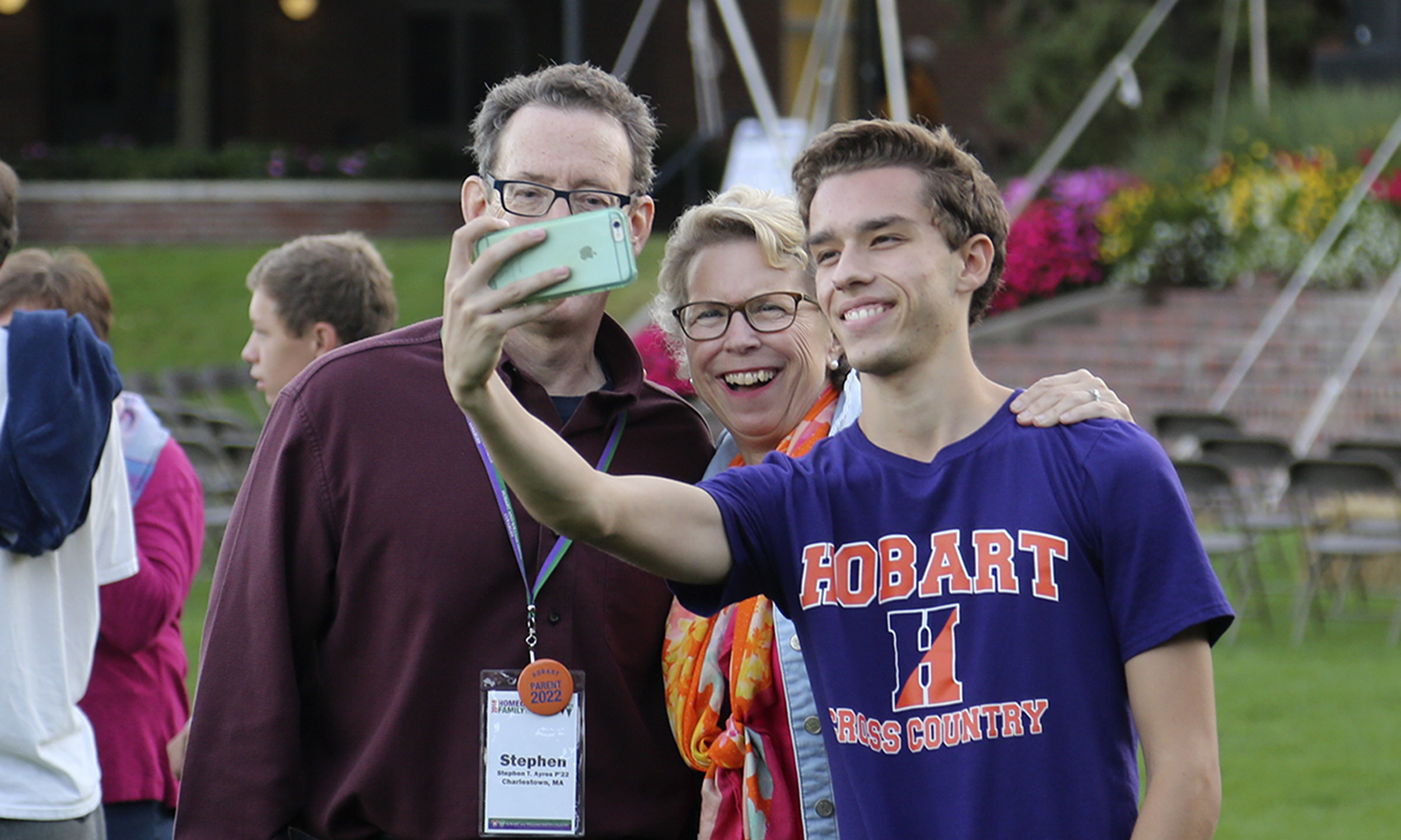 Matthew Ayres 'X takes a selfie with his family at Quadapalooza on Friday night of Homecoming and Family Weekend.