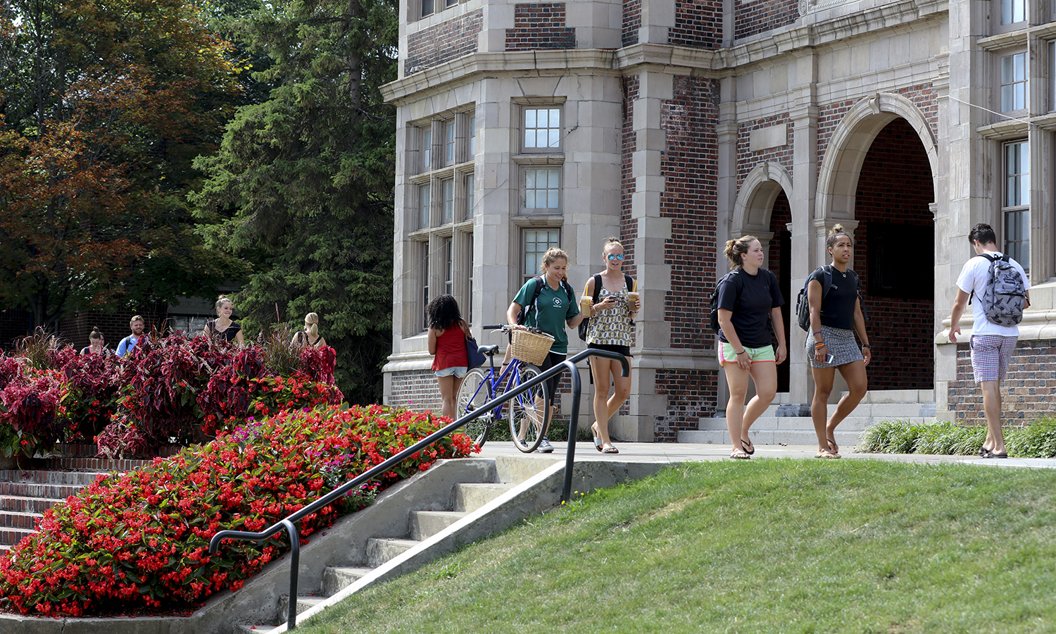 Students walking to class in front of Coxe Hall.