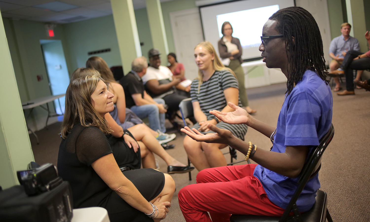 Jen Harris of the Education Department and Brandon Bryant, a former resident of Geneva and a member of Tools for Social Change! discuss language, race and education during a Fisher Center event Our Schools: Building an Anti-Bias Classroom.